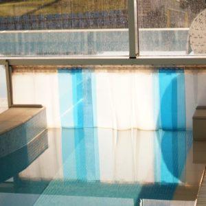 kurtyny paskowe na basen, izolacja termiczna