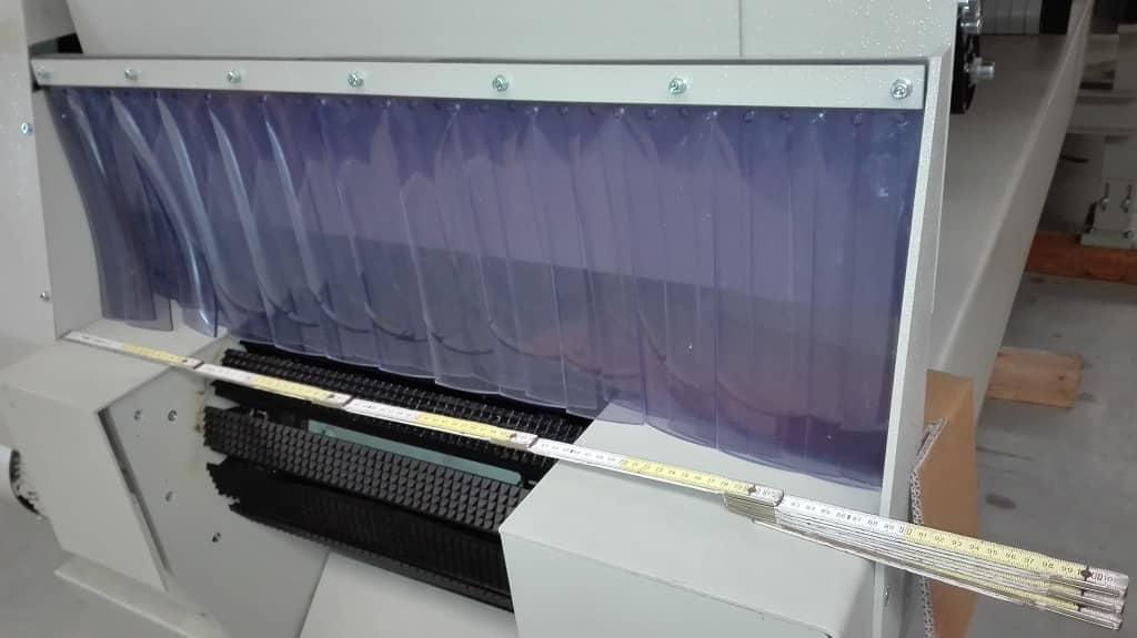 Klapa hamulcowa z folii PCV w maszynie do produkcji kartonów